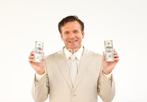 Serious businessman manager with dollars