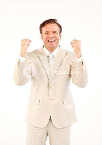 Mature businessman with fists