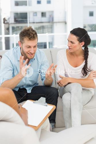 Unhappy man talking at couples therapy session