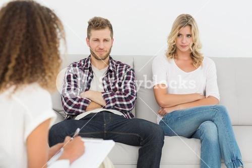 Unhappy couple not talking on the couch