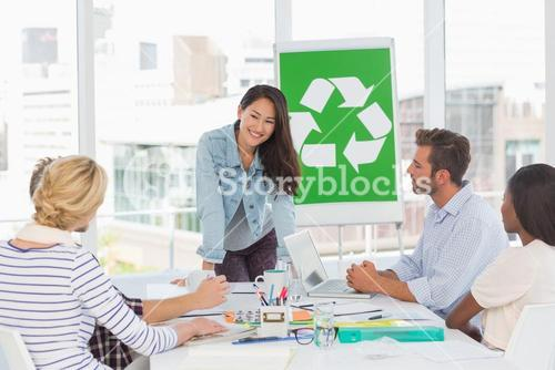 Happy team having a meeting about recycling policy