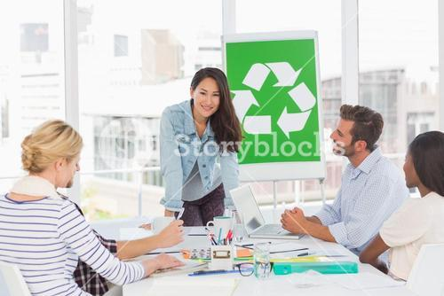 Smiling team having a meeting about recycling policy