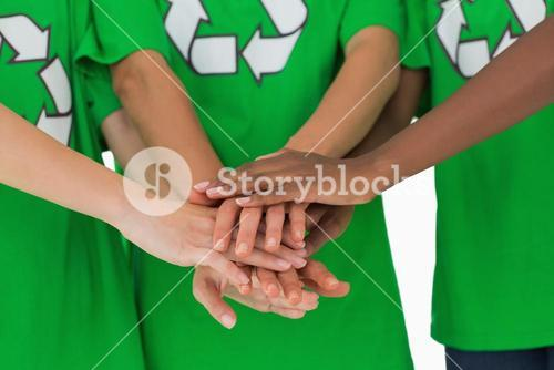 Environmental activists putting hands together