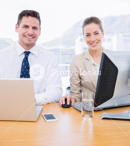 Smartly dressed colleagues using computer