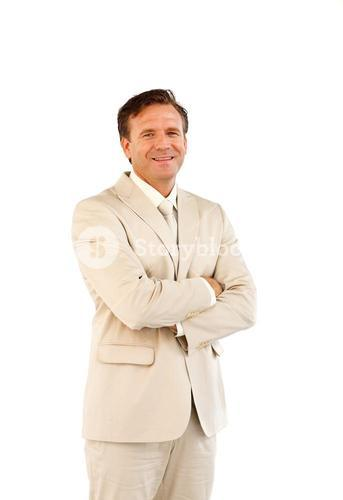 Charismatic business manager with folded arms