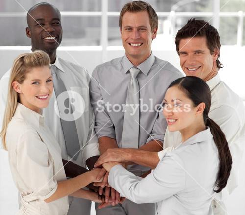 Close up of smiling business team with hands together
