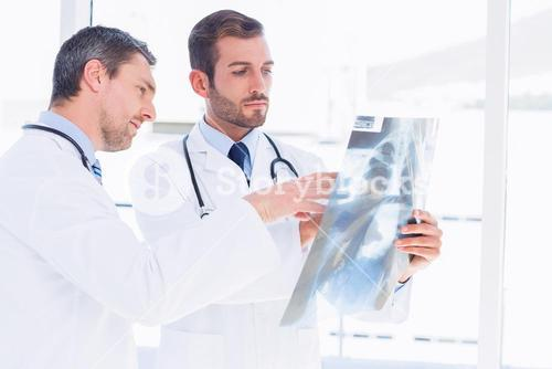 Doctors examining xray in medical office