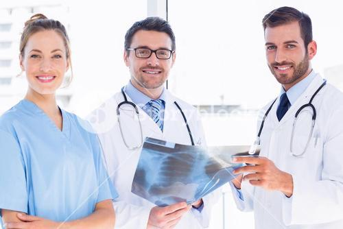 Portrait of doctors with xray report at medical office