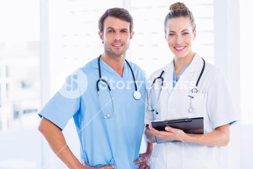 Male surgeon and female doctor with medical reports