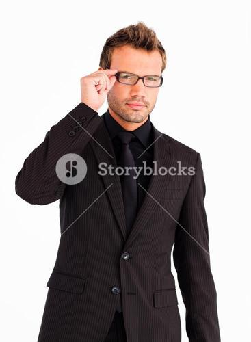 Young businessman with glasses looking at the camera