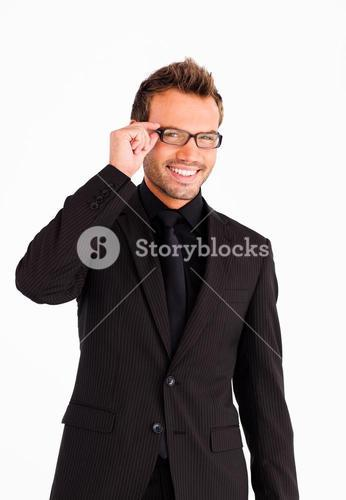 Handsome businessman with glasses looking at the camera
