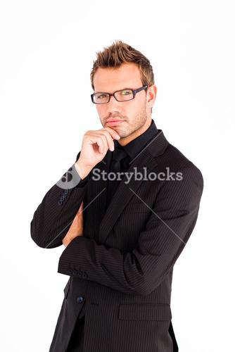 Confident businessman with glasses looking at the camera