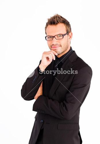 Serious businessman with glasses looking at the camera