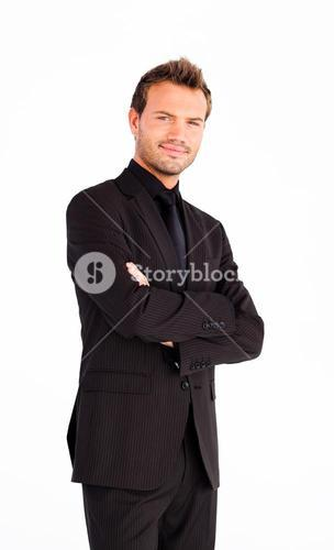 Friendly businessman with folded arms