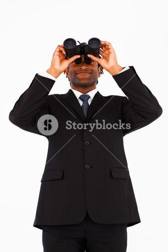 Friendly welldressed businessman with binoculars