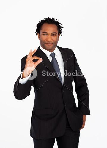 Serious businessman showing okay sign