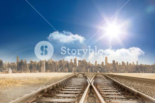 Train tracks leading to city