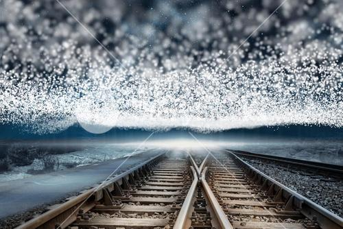 Train tracks under blanket of stars