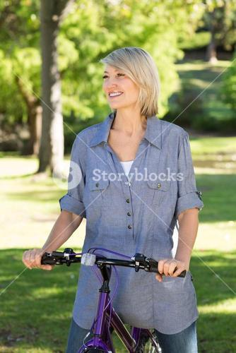 Happy woman riding bicycle