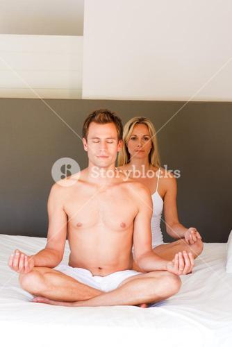 Young couple doing mediation buddha exercises