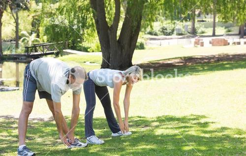 Active couple exercising in park