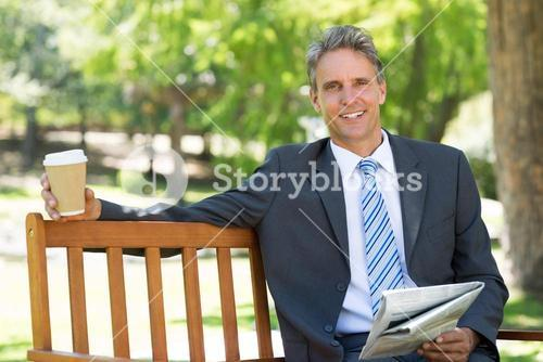 Businessman with newspaper and coffee cup