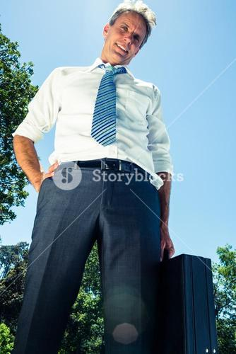 Confident businessman carrying briefcase