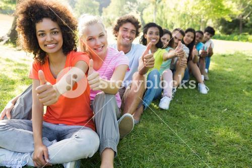 University students gesturing thumbs up
