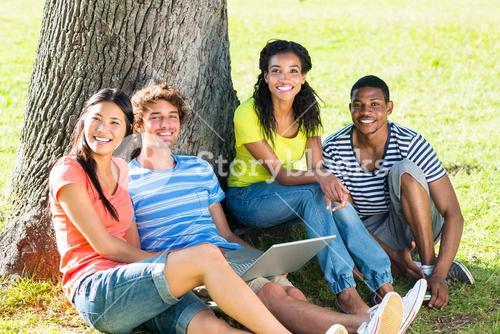 Happy students with laptop on campus
