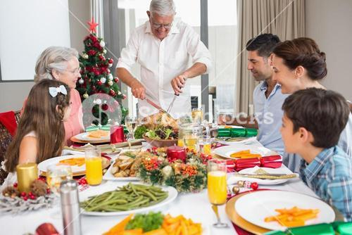 Extended family at dining table for christmas dinner