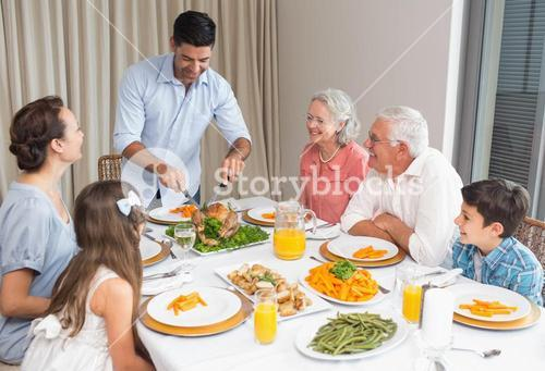 Extended family at dining table in house