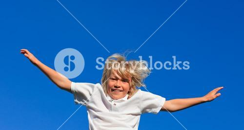 Smiling kid Jumping in the air