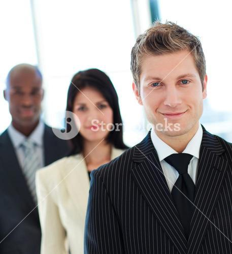 Friendly businessman in front of his team