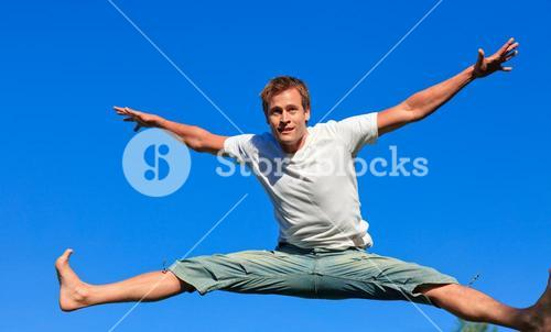 Delighted man jumping in the air