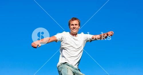 Lively man jumping in the air
