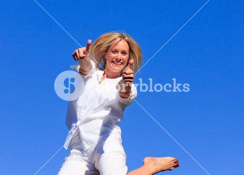 Delighted woman jumping in the air