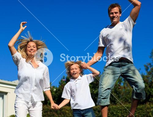Beautiful family jumping in the air