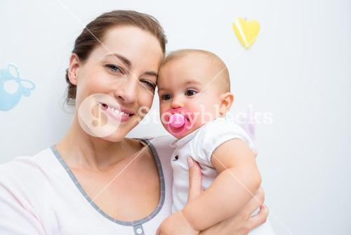 Closeup of mother and baby with pacifier