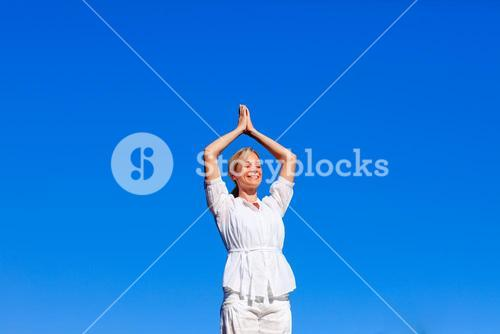 Young woman practising yoga with copyspace