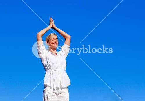 Young girl practicing yoga with copyspace