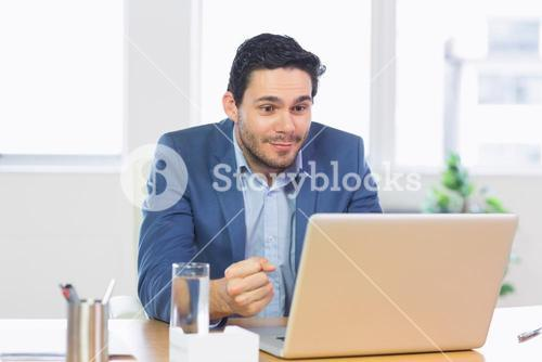 Successful businessman looking at laptop