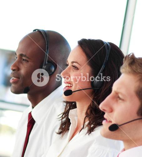 Smiling people with a headset on working