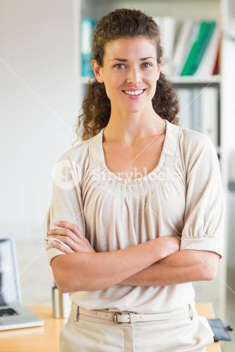 Businesswoman with arms crossed in office