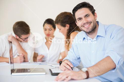 Happy businessman in meeting room