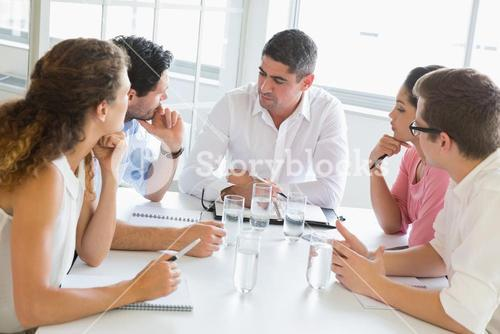 Business people discussing at table