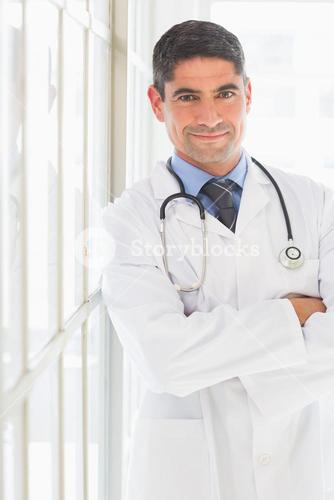 Doctor standing arms crossed