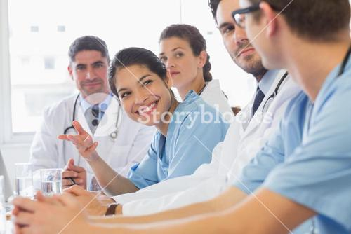 Smiling nurse looking at colleagues