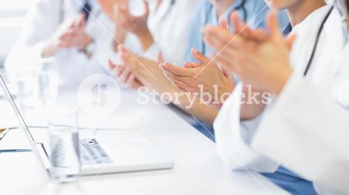 Medical team clapping
