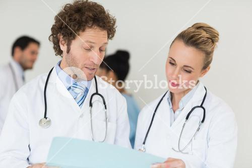 Medical team discussing over file