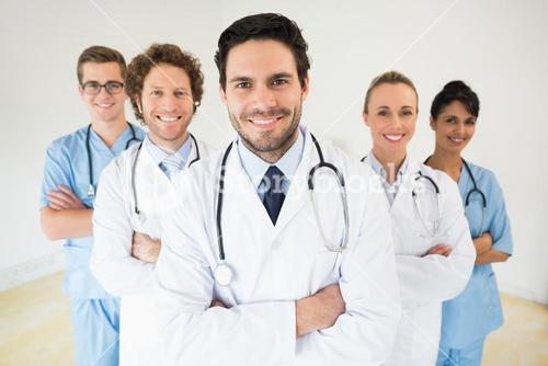 Male doctor with colleagues in hospital